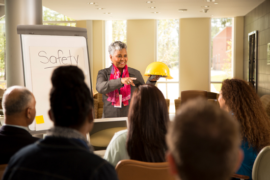 Safety in the workplace. Presentation with office workers.