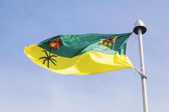 Saskatchewan flag against blue sky