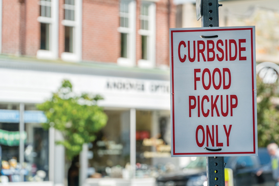 """Close-up of sign outside of restaurant stating """"Curbside Food Pi"""